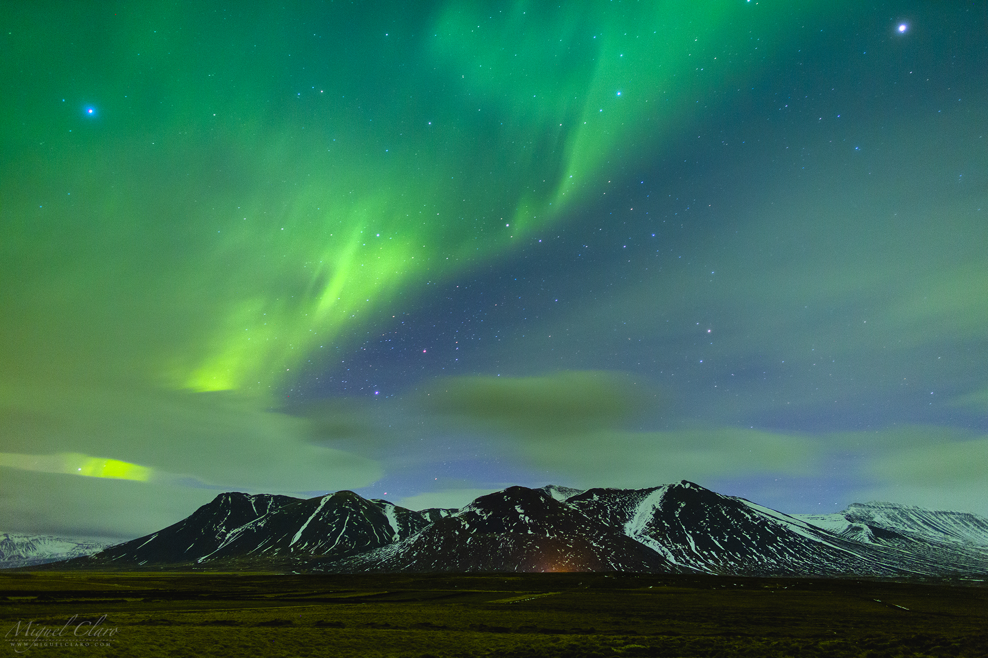 Green Lights Over Snowy Mountains From Iceland Astrophotography By